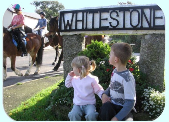 Children at Whitestone sign